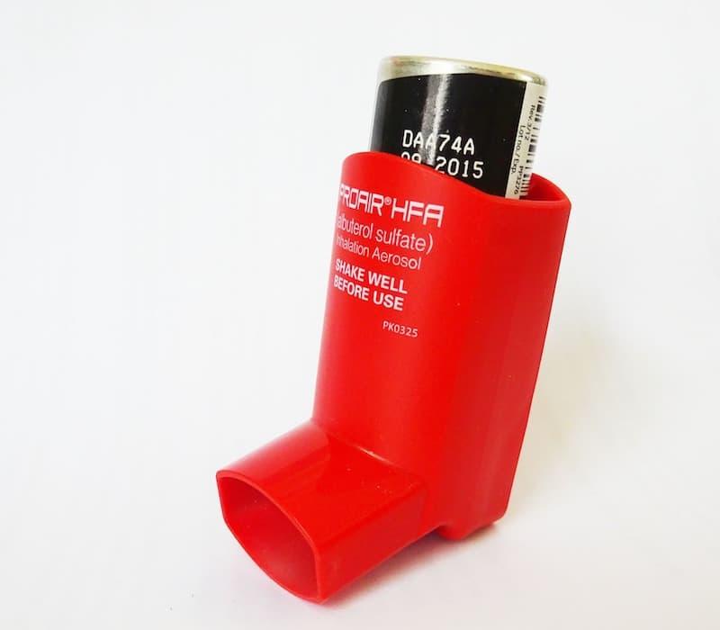 People with asthma take medication through an inhaler.