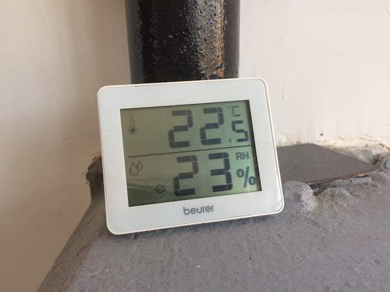 A hygrometer showing a low humidity in a house